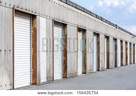 Self Storage Unit Shutter door or roller door of factory building use for industrial background.