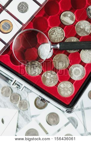 Different Old Coins And Magnifying Glass
