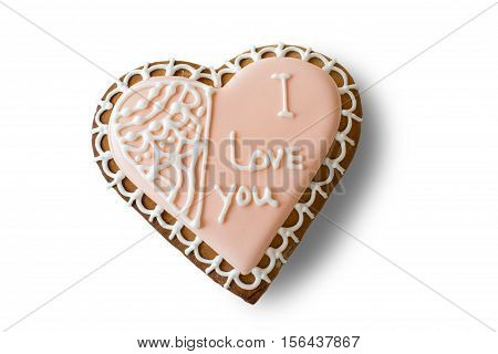Heart shaped biscuit with inscription. Frosted cookie of pink color. Make a confession in love. Small present that brings joy.