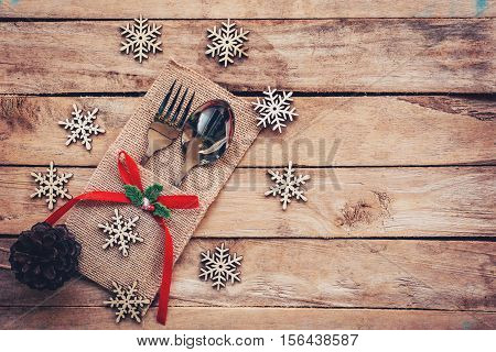 Christmas Table Place Setting And Silverware, Snowflakes, Pine Cones On Wooden Background With Space