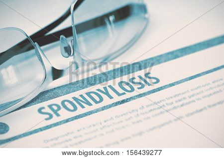 Spondylosis - Printed Diagnosis on Blue Background and Glasses Lying on It. Medicine Concept. Blurred Image. 3D Rendering.