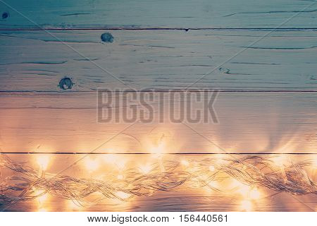 Christmas Light And Christmas Decoration On White Wood Background With Copy Space.