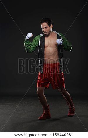 Muscular Asian Male Boxer Training Uppercut Punching