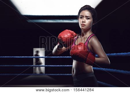 Attractive Asian Female Boxer In Boxing Arena