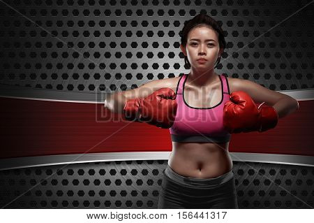 Young Asian Boxer Woman With Red Gloves