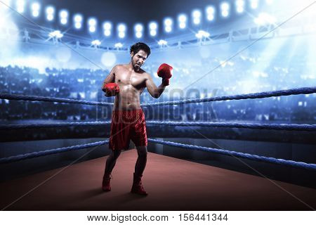 Asian Boxer Guy Training Uppercut Before The Game