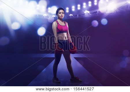 Smiling Asian Boxer Woman With Boxing Glove