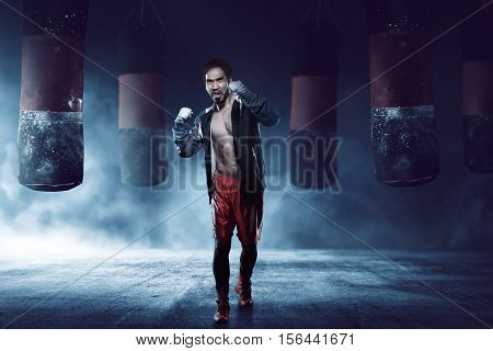 Muscular Asian Adult Boxer Man Training