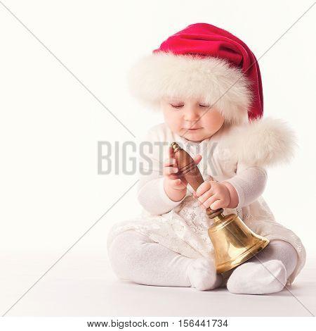 baby santa claus with red fur cap