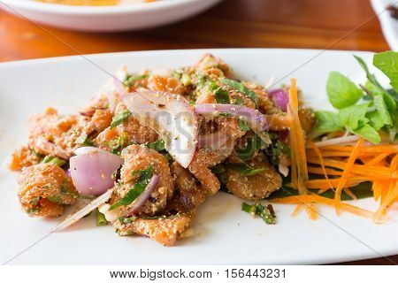 Spicy Salmon Salad And Vegetable On White Dish