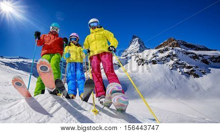 Skiing, winter, snow, sun and fun - family enjoying winter vacations in Zermatt, Switzerland.