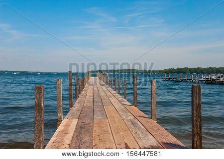 Pier on Lake Spirit at bright summer day Arnolds Park, Iowa, USA