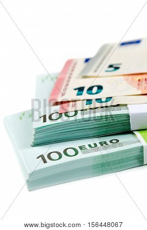 stack of bills with 100 10 and 5 euros isolates on white