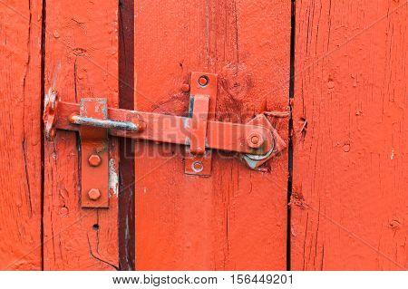 Old Metal Latch On Red Wooden Door