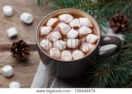 Cup of hot chocolate on wooden rustic table. Delicious winter drink.