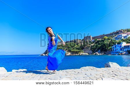 beautiful young brunet woman in blue clothes