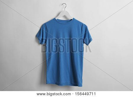 Blank blue t-shirt on light background