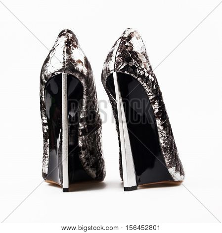 female silver high heels over white background