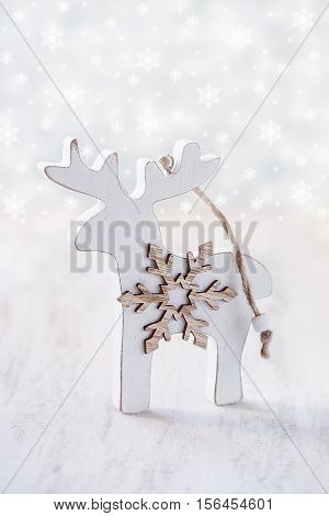 Christmas Decoration.Wooden toy reindeer for a Christmas tree .