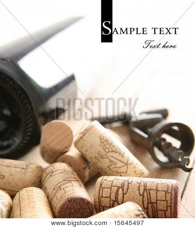 Corkscrew next to the bottle of red wine (easy to remove the text)