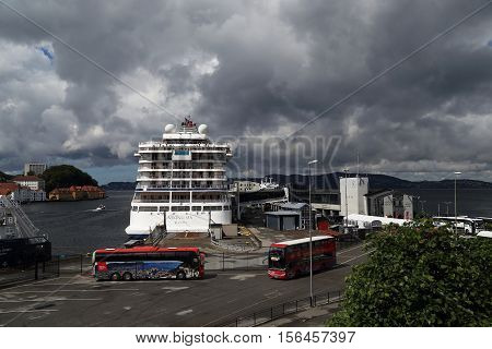 BERGEN, NORWAY - JULY 3, 2016: This is one of the cargo and passenger sea berths town near the castle Bergenhus.
