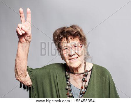 Stylish seniors 90 years old woman. Studio shot. Granny female