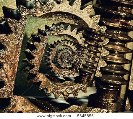 Collage of Gear wheels cogs and screw of machine part. Digitally altered image