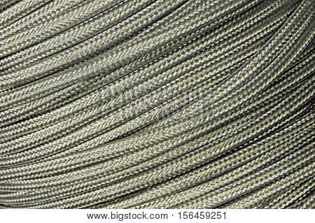 Flexible metal hose taken closeup suitable as industrial background.