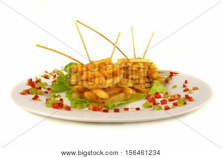 Serving of French fries on a white background