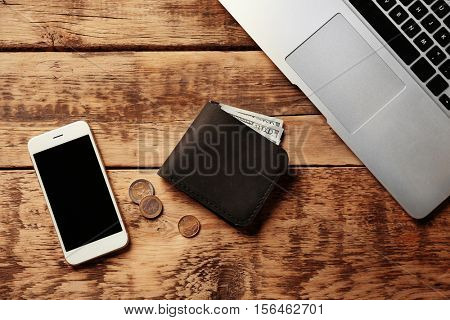 Workplace with stylish leather wallet and smartphone