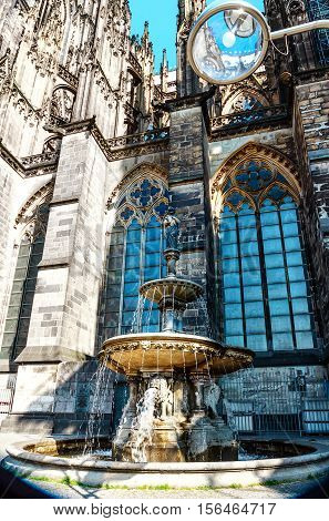 Fountain on the south side of the famous Cathedral in Cologne, North- Rhine Westphalia, Germany