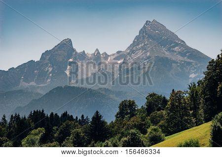 Watzmann mountain peak on hazy summer day Bavarian Alps Germany