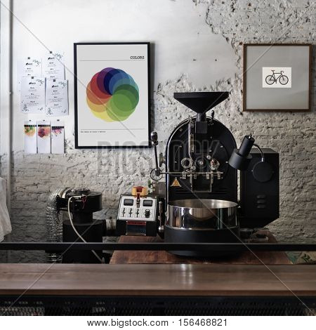Coffee roaster with photo frames on the wall
