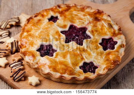 homemade cherry pie on a wooden table