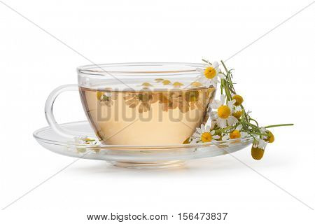 Cup of medicinal chamomile tea on a wooden