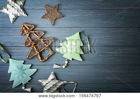 Handmade Christmas trees and some decor on wooden background