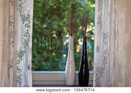 On the windowsill / Ornamental vases standing on the windowsill