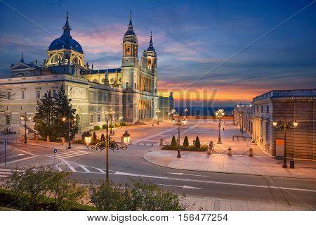 Madrid. Image of Madrid, Spain with Santa Maria la Real de La Almudena Cathedral during sunset.