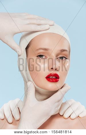Photo of model with unusual image. isolated biege background.