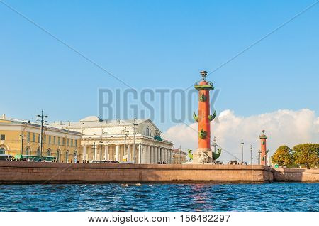 Saint Petersburg panorama - Neva river and Saint Petersburg landmarks of Vasilievsky island spit - rostral column and stock exchange building in Saint Petersburg Russia