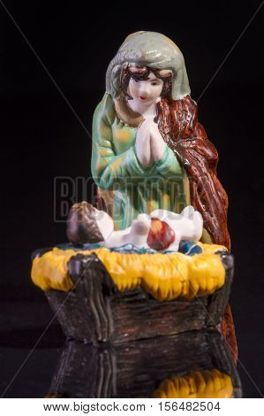 Christmas scene with Jesus and Mary on black background. Focus on Mary!