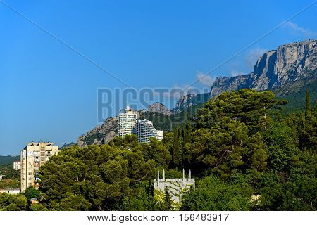 The town in the mountains under the blue sky