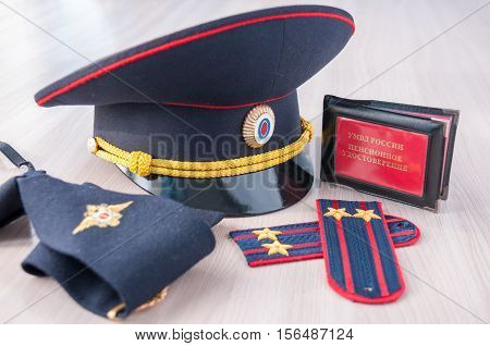 Pension certificate AMIA Russian next to the police cap