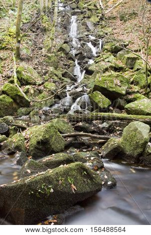 A stream joins Burbage Brook in the rocky valley of Padley Gorge, Longshaw Estate, Peak District, Derbyshire, UK