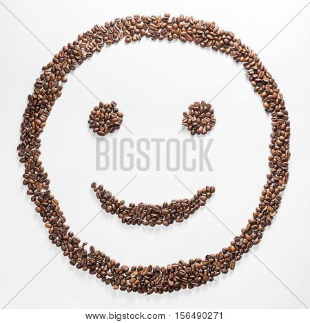 Smile shaped coffee beans isolated on white background. Smile shaped coffee beans isolated on white background. composition for bloggers, designers, websites