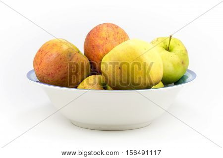 Colorful Windfall Apples In A Bowl On A White Background.