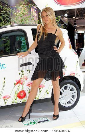 PARIS, FRANCE - OCTOBER 02:  female model posing near car at Paris Motor Show 2008 on October 02, 2008