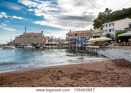 PETROVAC, MONTENEGRO - SEPTEMBER 20, 2016:The old town of Petrovac with the ruins of a medieval fortress and the bay for tourist and fishing vessels,Montenegro.