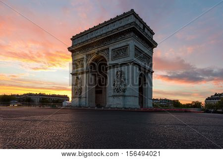 Arc de Triomphe and Champs Elysees Landmarks in center of Paris at sunset. Paris France