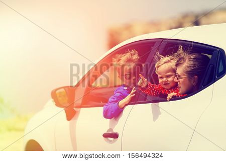 mother with son and daughter travel by car, family travel